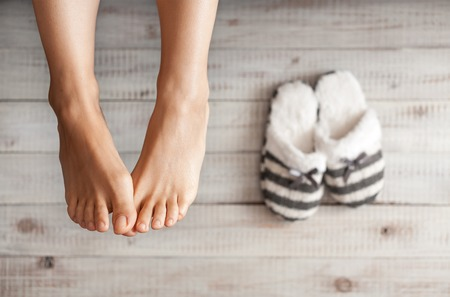 Soft photo of woman's feet with slippers, top view point Standard-Bild