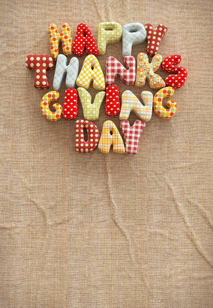 Autumn Thanksgiving Day composition with handmade text on canvas background. Unusual thanksgiving day illustration. Top view illustration