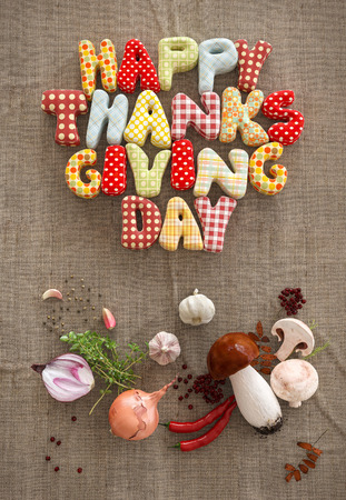 Autumn Thanksgiving Day composition with handmade text and vegetables on canvas background. Unusual thanksgiving day illustration. Top view illustration