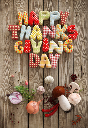 Autumn Thanksgiving Day composition with handmade text and vegetables on wooden background. Unusual thanksgiving day illustration. Top view illustration