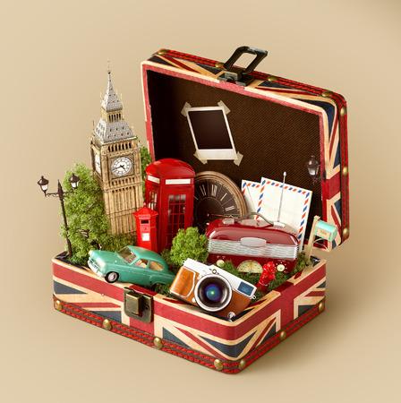 Scatola aperta con bandiera britannica e famosi monumenti di Londra all'interno. Concetto di viaggio insolito.