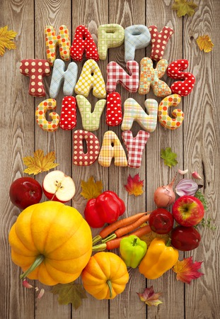 Autumn Thanksgiving Day composition with handmade text, fruits and vegetables on wooden background. Unusual thanksgiving day illustration. Top view