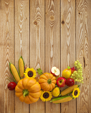 Autumn Thanksgiving Day composition fruits and vegetables on wooden background. Unusual thanksgiving day illustration. Top view illustration