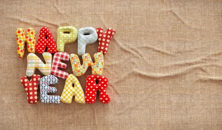 stitched: Colorful stitched letters. Happy new year text on canvas background