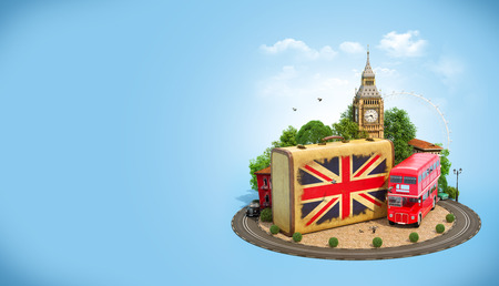 unusual: Old suitcase with british flag, Big Ben, double decker and red phone booth on a square. Unusual traveling concept. Stock Photo