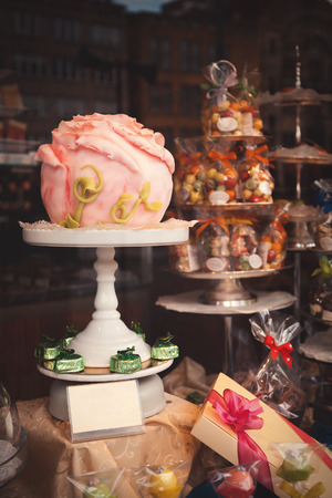 roze: Candy shop showcase from outside in European town