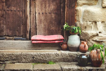 doorstep: Ancient doorstep and old wooden door Stock Photo