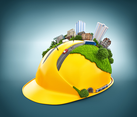 construction project: City on the construction helmet. Stock Photo