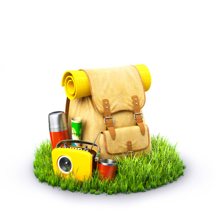 Backpack with termos, map and radio on grass at blue background. Unusual travel background Stock Photo