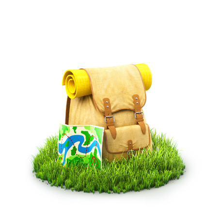 Backpack with the map on grass at white background. Unusual travel background Banco de Imagens