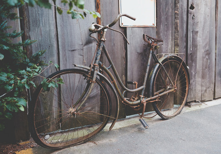 Old rusted bicycle standing at the street