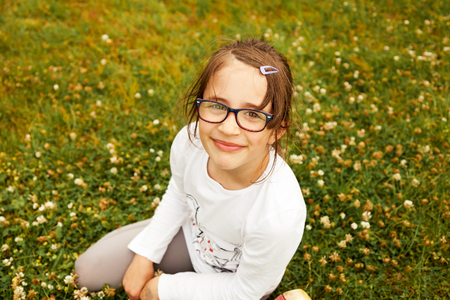 child portrait: Cute little girl on the meadow in summer day