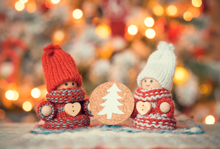 christmas cute: Little cute gnomes at christmas tree background Stock Photo