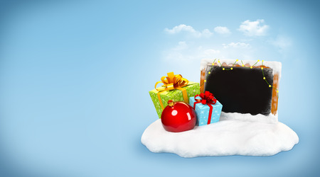 snowdrift: Christmas gift boxes and empty blackboard on snowdrift at blue background. Unusual christmas illustration