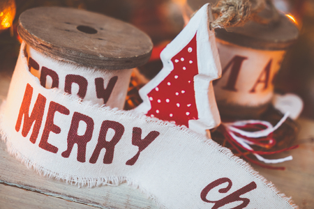 christmas vintage: Beautiful vintage christmas ribbons and toys on the wooden table. Cute and pleasant decorations in rustic style Stock Photo
