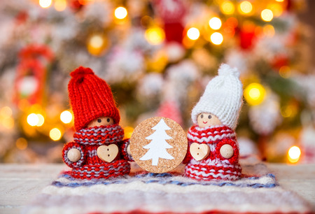 Little cute gnomes at christmas tree background Stock Photo
