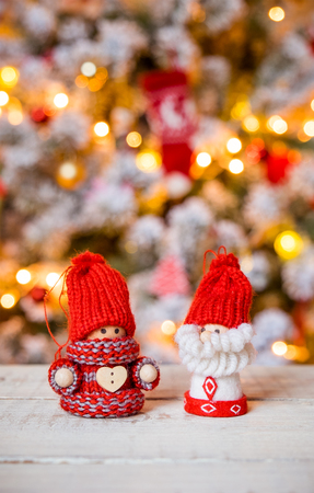 gnomes: Little cute gnomes at christmas tree background Stock Photo
