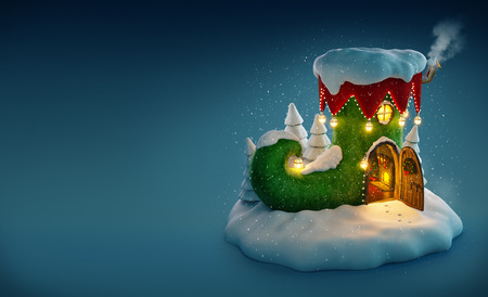 elf hat: Amazing fairy house decorated at christmas in shape of elfs shoe with opened door and fireplace inside. Unusual christmas illustration. Stock Photo