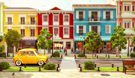 Cute little car goes by the road in a  wonderful European town