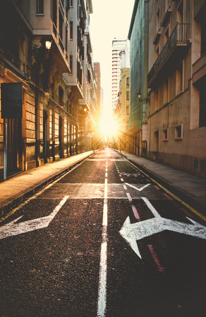 Empty road of a city at sunset.