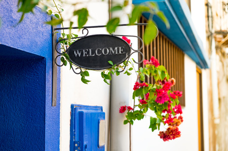 open country: Welcome signboard near a door Stock Photo