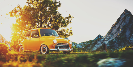 Cute little retro car goes by wonderful countryside road at sunset