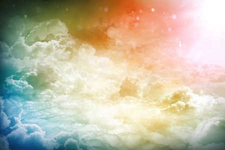 bright sky: Over the Clouds. Fantastic background with clouds and sunlight beams Stock Photo