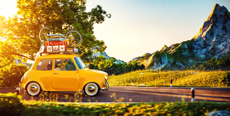 Cute little retro car with suitcases and bicycle on top goes by wonderful countryside road at sunset 免版税图像 - 58550515