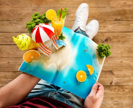 Tropical island with palms, ice cream and fresh juice on a page of opened magazine in hands. Unusual travel 3d illustration. Summer travel and vacation concept