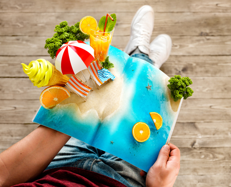 palm: Tropical island with palms, ice cream and fresh juice on a page of opened magazine in hands. Unusual travel 3d illustration. Summer travel and vacation concept
