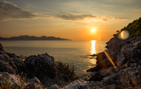 Amazing landscape of sunset over the sea at island in Greece
