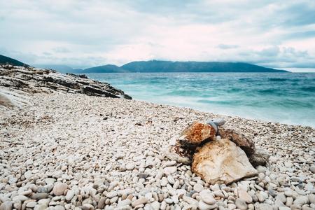 Amazing landscape of pebble stones beach at blue sea