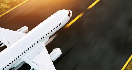 Weißes Handelsflugzeug, das auf der Flughafenrollbahn bei Sonnenuntergang steht. Passagierflugzeug hebt ab. Illustration des Flugzeugkonzeptes 3D. Standard-Bild - 84910687