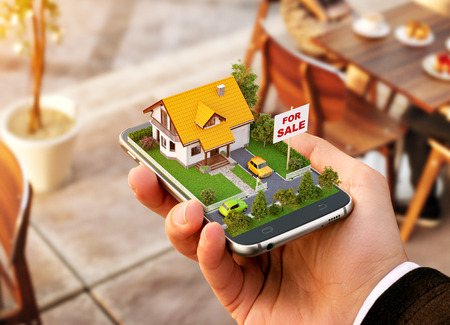Smartphone application for online searching, buying, selling and booking real estate. Unusual 3D illustration of beautiful house on smartphone in hand Banco de Imagens - 85543980