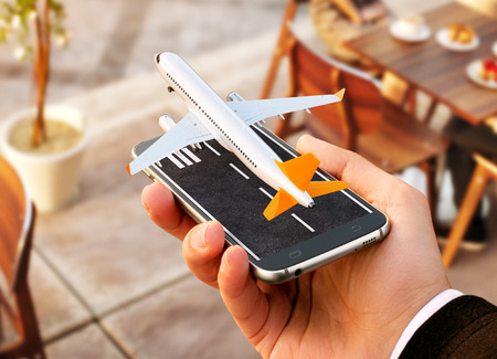 Smartphone application for online searching, buying and booking flights on the internet. Online check-in. Unusual 3D illustration of commercial airplane taking off on smartphone in hand