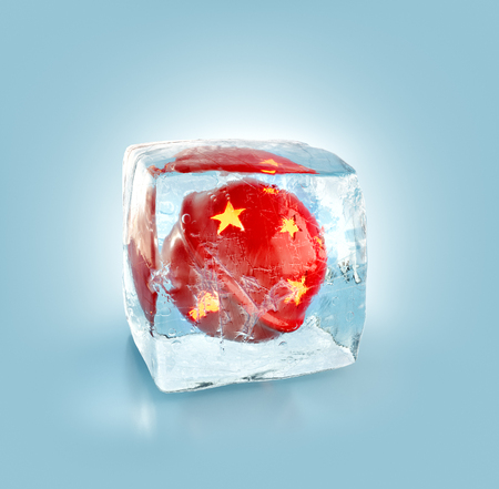 Beautiful red Christmas bell inside ice cube. Unusual 3d illustration. Christmas concept Stock Photo