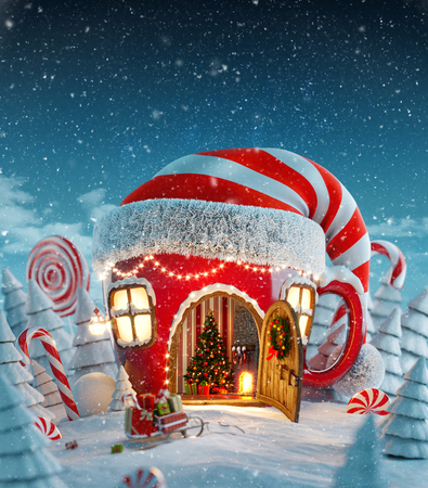 Amazing fairy house in elfs hat decorated at christmas in shape of tea cup with opened door and fireplace inside in magical forest. Unusual christmas 3d illustration postcard Imagens - 89399035