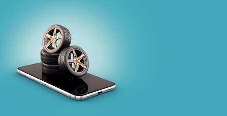 Unusual 3d illustration of car tires on a smartphone screen. Tire Size Calculator. Choosing and buying tires online concept Фото со стока