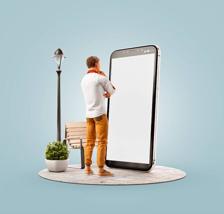 Unusual 3d illustration of a young man standing at big smartphone with blank screen and using smart phone application. Smartphone apps concept.