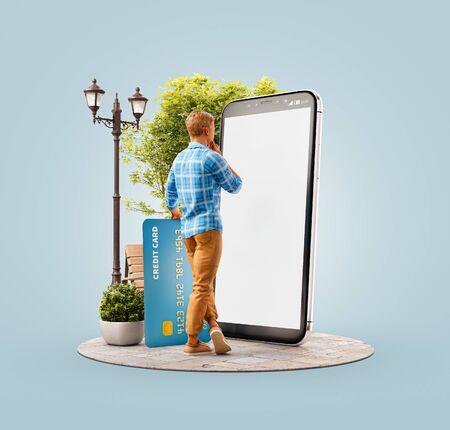 Ungewöhnliche 3D-Darstellung eines jungen Mannes mit Kreditkarte, der draußen auf einem großen Smartphone steht und eine Smartphone-Anwendung zum Einkaufen einer Zahlung verwendet. Online-Zahlungskonzept.