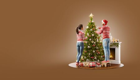 Unusual 3D illustration of happy family decorating beautiful Christmas tree at fireplace at home. Merry Christmas and Happy New Year concept.