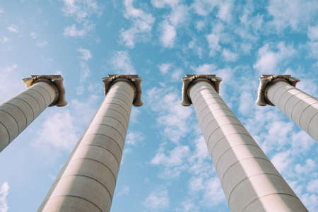Greek columns at the sky background. Imagens