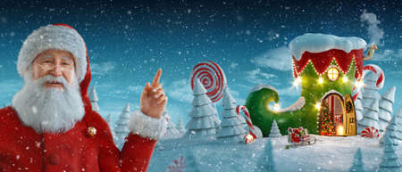 Santa Claus pointing at blank space. Amazing fairy house in shape of elfs shoe decorated at christmas in magical forest. Christmas 3d illustration postcard. Merry Christmas and Happy new year concept