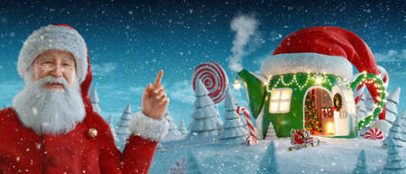 Santa Claus pointing at blank space. Amazing house in shape of teapot in red elfs hat decorated at christmas in magical forest. Christmas 3d illustration. Merry Christmas and a Happy new year concept