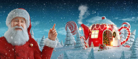 Santa Claus pointing at blank space. Amazing fairy house decorated at christmas in shape of teapot in magical forest with spurces and candy canes. Unusual christmas 3d illustration 版權商用圖片