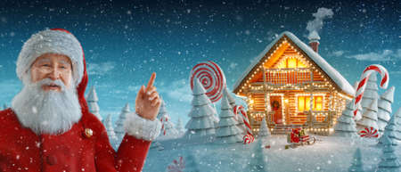 Santa Claus pointing at blank space. Amazing log house decorated at christmas of christmas lights in magical forest. Unusual christmas 3d illustration postcard