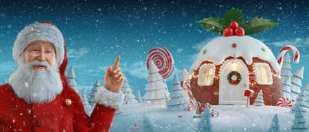 Santa Claus pointing at blank space. Amazing house decorated at Christmas in shape of traditional Christmas homemade pudding with holly berries and Christmas lights. Unusual Christmas 3d illustration.