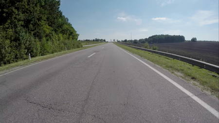 quite time: Driving on the highway near the forest. HD Video Stock Photo