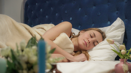 Red alarm sounds, the girl is sleeping off and on. UHD video