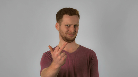 caucasian guy with red hair posing showing hand gesture fuck off handsome redhead men wearing in casual t- shirt. Portrait young caucasian man on grey background